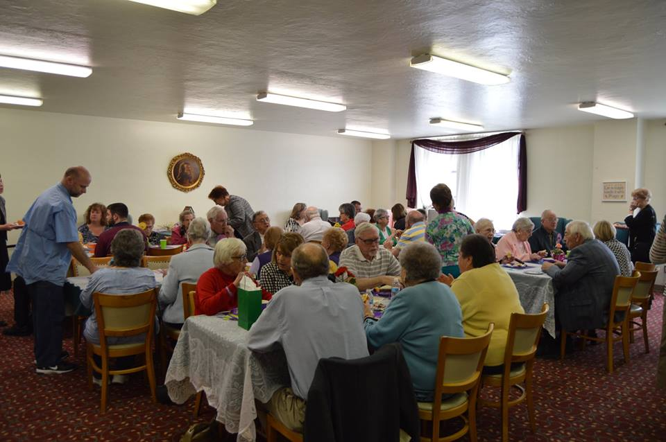 Gathering of congregants for fellowship events at St. Andrews