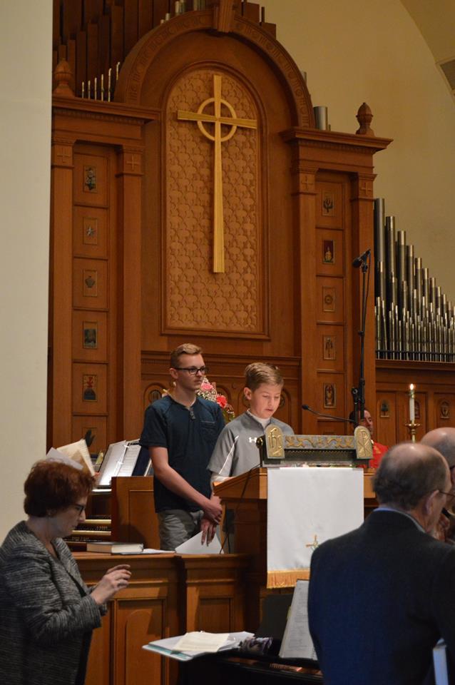 Children singing at Saint Andrews